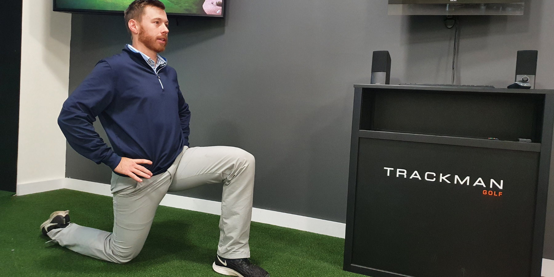 trainer stretching hip