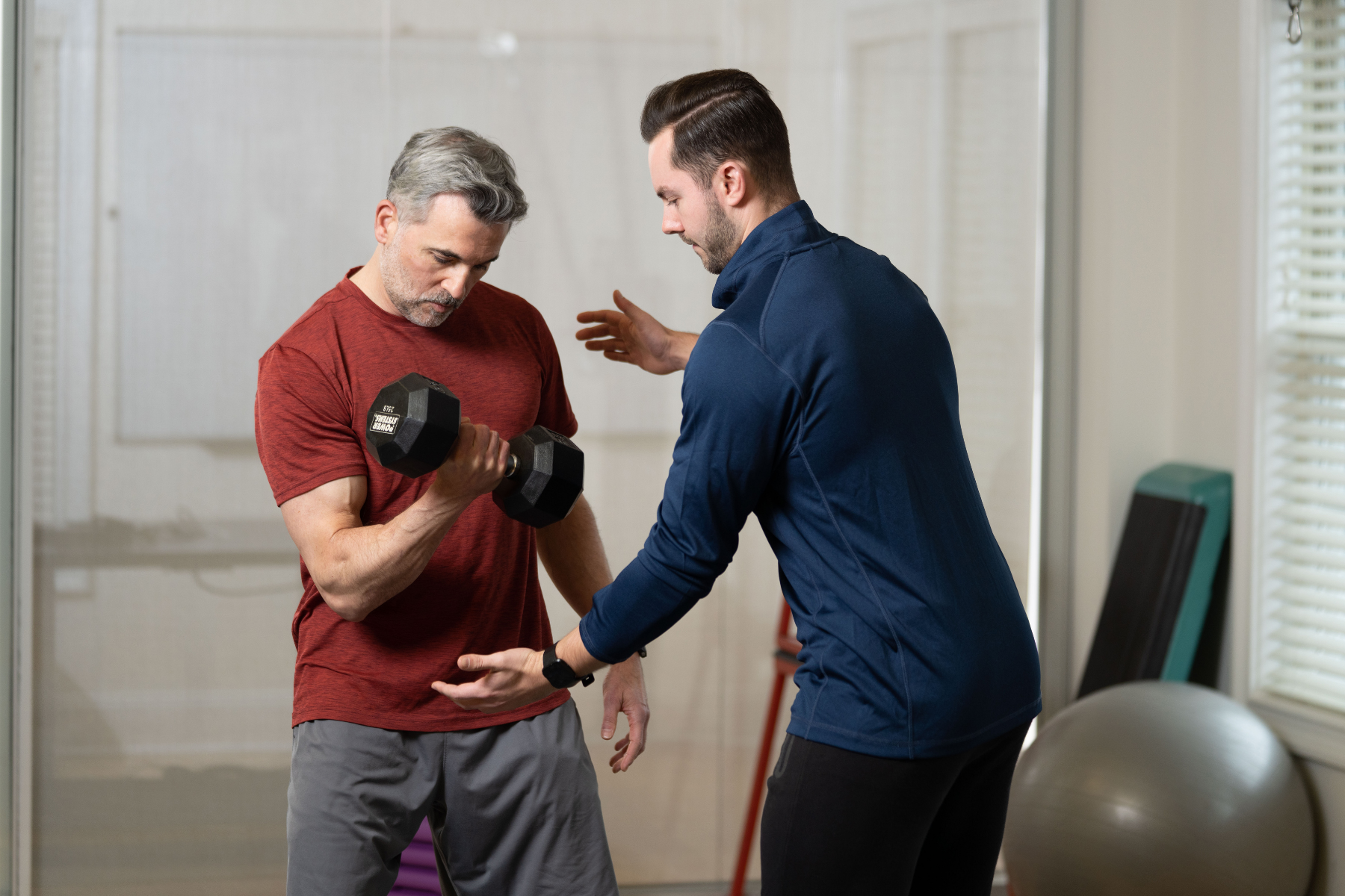 trainer coaching a client