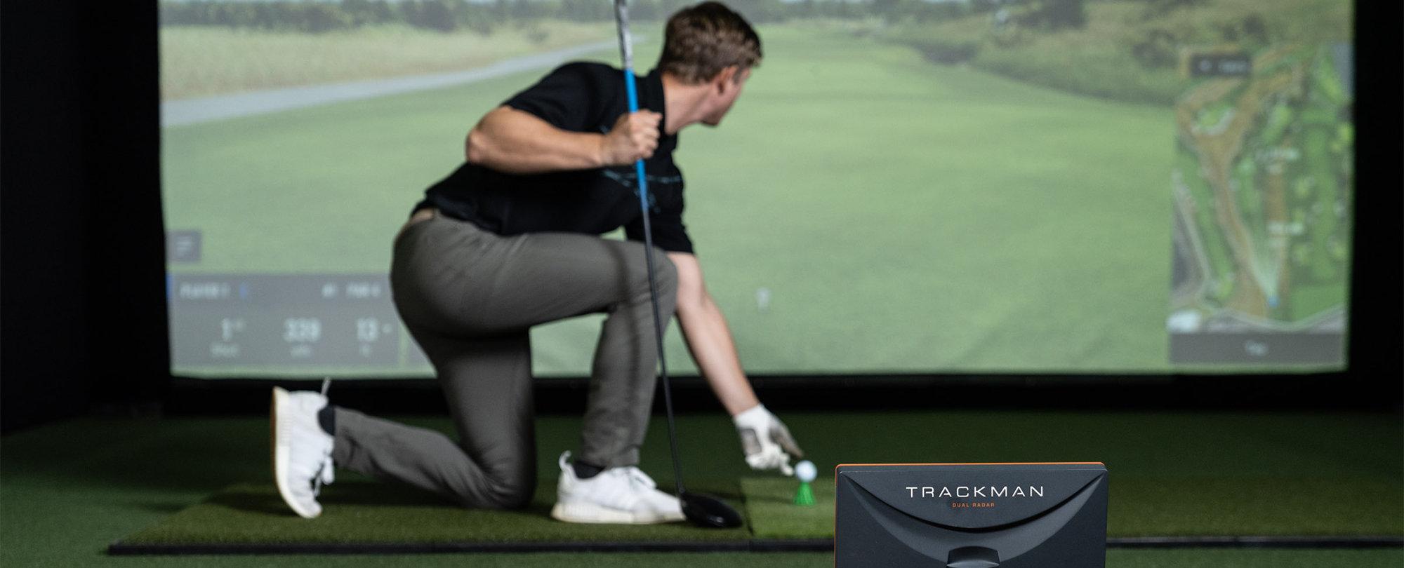 man using a golf simulator