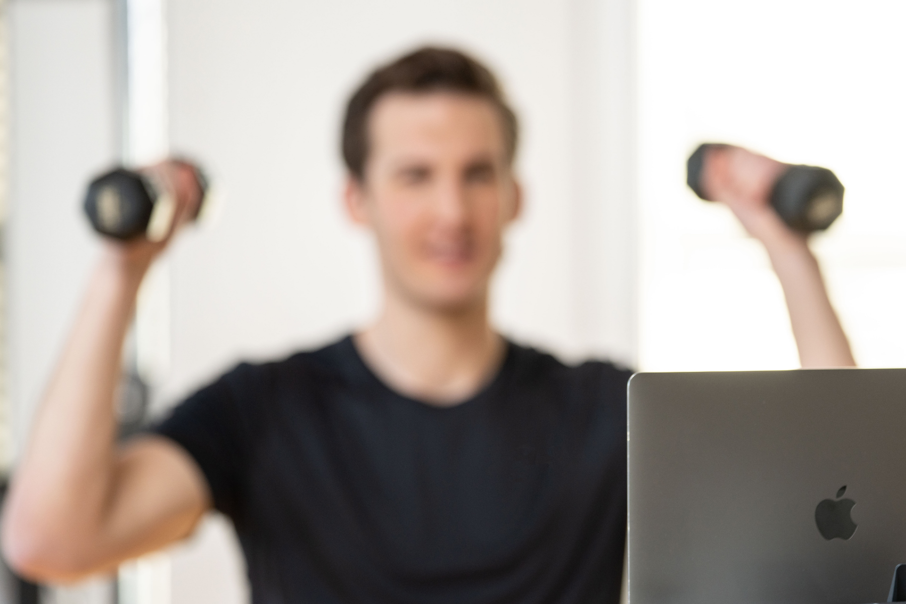 man working out in front of a laptop