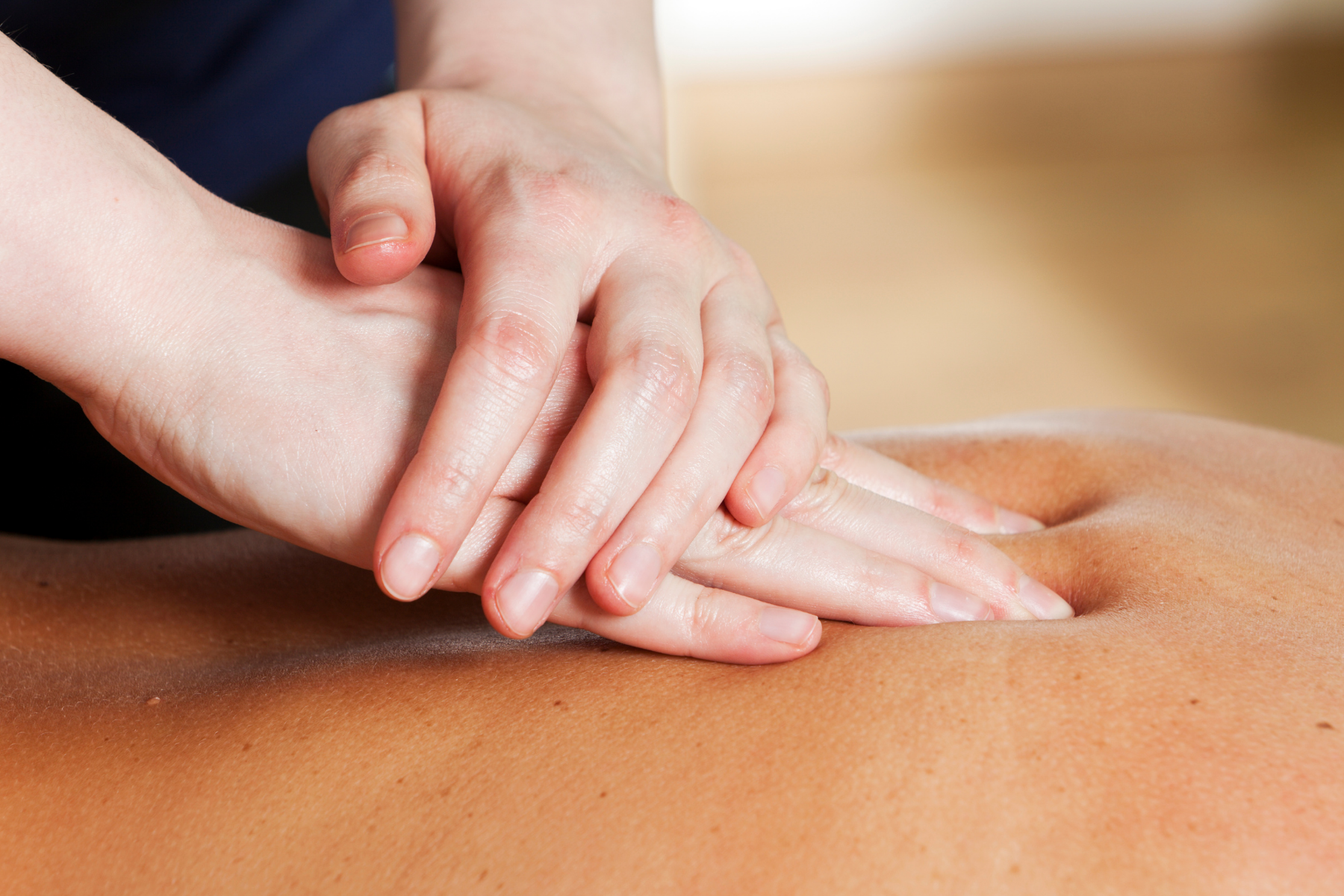 woman giving a back massage
