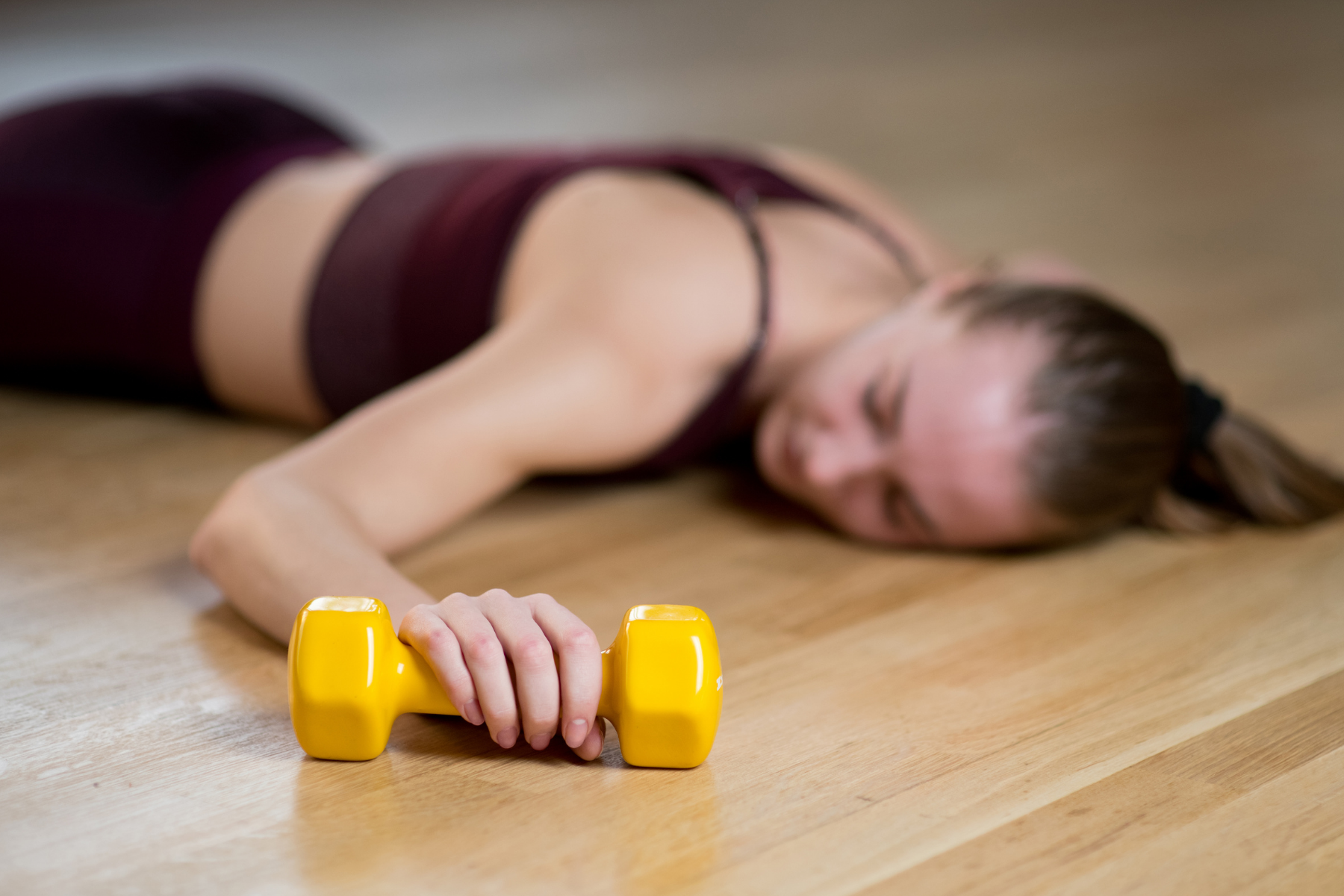 woman tired after a weight lifting workout