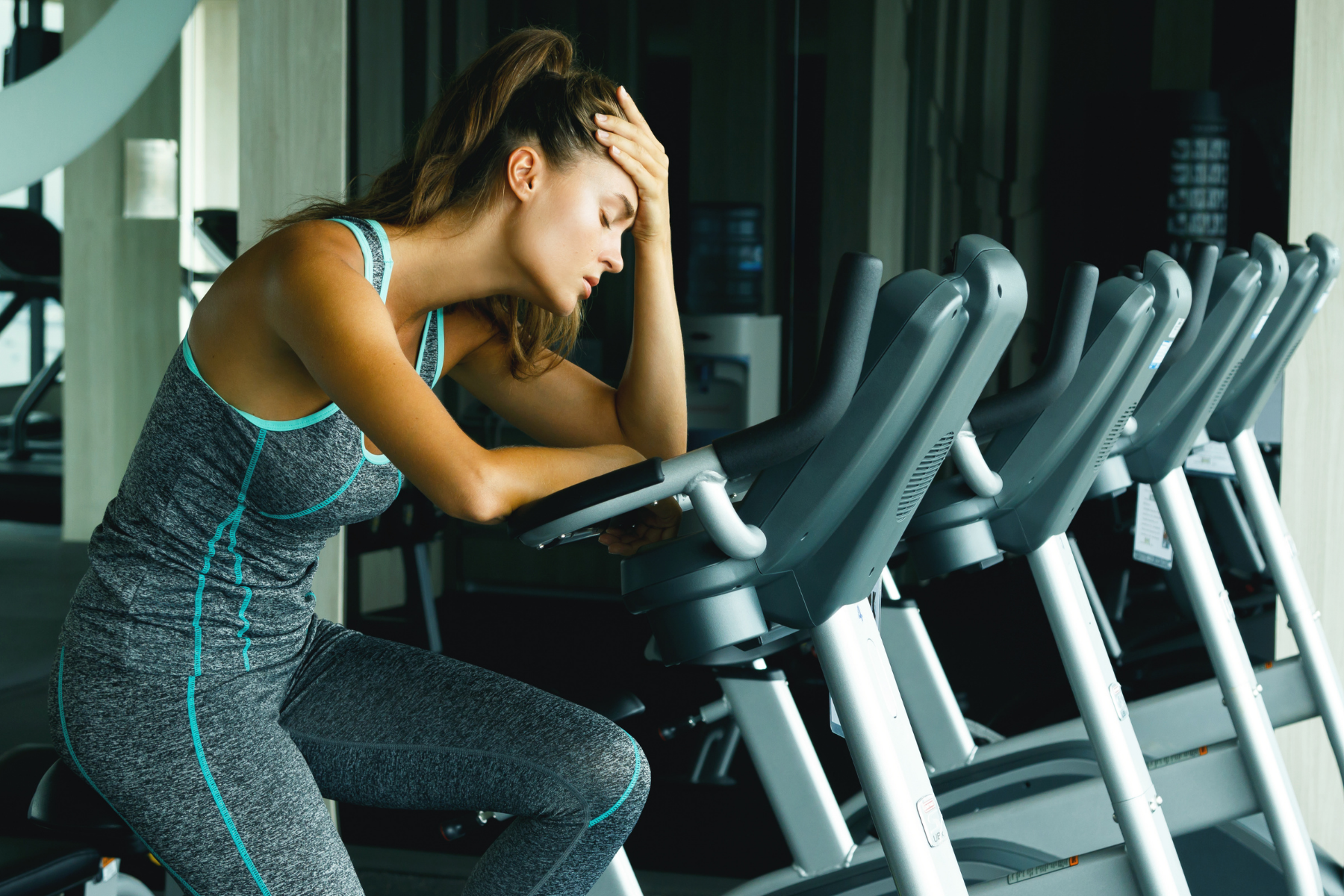 Woman tired on a treadmill