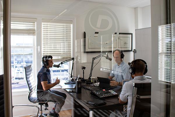men recording podcast
