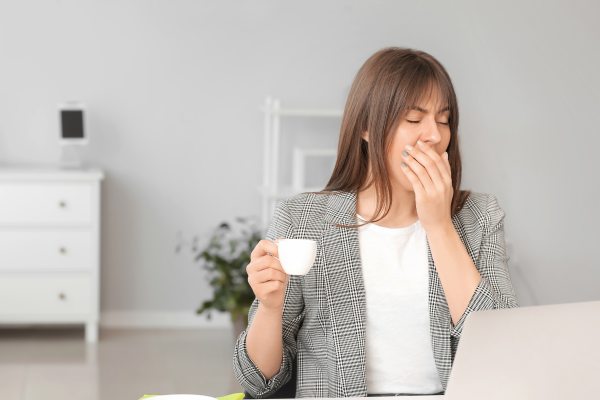woman yawning while working