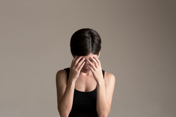 Stressed woman holding her head